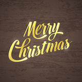 Gold Merry christmas on wood background greeting card Royalty Free Stock Photo