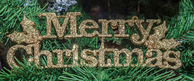 Gold Merry Christmas write, Christmas ornament tree, detail, close up.  stock photos
