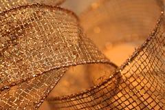Gold Mesh Ribbon. Extreme closeup of curls of gold mesh ribbon royalty free stock photography