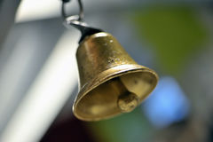 Gold metal bell. In restaurant Royalty Free Stock Photography