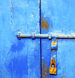 gold  metal blue in    africa the old wood  facade home and safe pa Royalty Free Stock Image