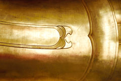 Gold metal Buddha statue abstract background Stock Photo
