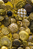 Gold metal buttons. A large assortment of metellic golden buttons Royalty Free Stock Photography