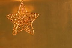 Gold metal Christmas ornament Stock Image