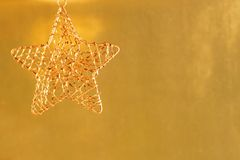 Gold metal Christmas ornament Royalty Free Stock Photos
