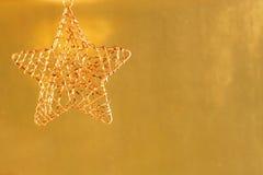 Gold metal Christmas ornament Royalty Free Stock Photos