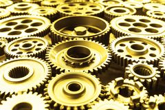 Gold metal cog wheels. Stock Photos