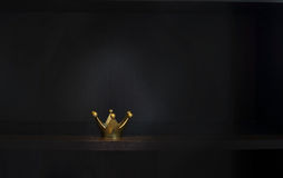Gold metal crown. On dark background with copy space stock photos