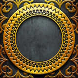 Gold metal frame on black metal Stock Photos