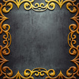 Gold metal frame on black metal Royalty Free Stock Image