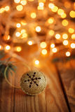 Gold Metal Jingle Bell with snowflake on Wooden Stock Photos