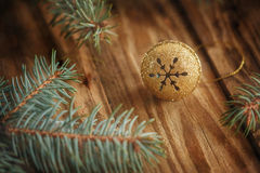 Gold Metal Jingle Bell with snowflake on Wooden Royalty Free Stock Photos