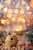 Gold Metal Jingle Bell with star on Wooden Table with boke and g Stock Photos