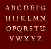 Gold metal letters in red background. Vector alphabet illustration Stock Images