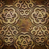 Gold metal pattern on paper backgrond Royalty Free Stock Image