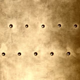 Gold metal plate or armour texture with rivets Stock Photo