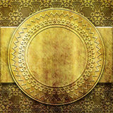 Gold metal plate with classic ornament Stock Photo