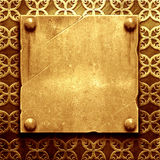 Gold metal plate with classic ornament Royalty Free Stock Photos