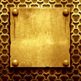 Gold metal plate with classic ornament Stock Images