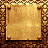 Gold metal plate with classic ornament Royalty Free Stock Images
