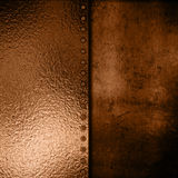 Gold metal plate on grunge background Stock Photography