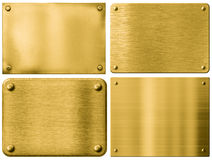Gold metal plates or signboards set with rivets Stock Images