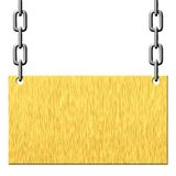 Gold metal signboard hanging on chains Stock Photo
