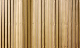 Gold metal wall panel background. Royalty Free Stock Photo