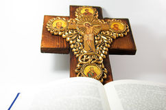 Gold metal and wood cross and a book. Religion photo gold cross and book Royalty Free Stock Photography