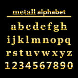 Gold metall alphabet and gold numbers Stock Image