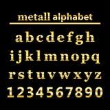Gold-metall Alphabet- und Goldzahlen Stockbild