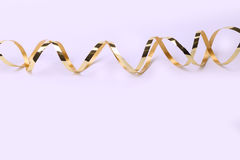 Gold metallic curly ribbon on a White background Stock Photo