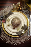 Gold metallic theme Christmas  formal dinner table place setting - vertical. Royalty Free Stock Photos