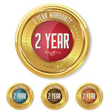 Gold metallic two year warranty button Stock Image