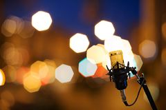 Gold Mic on bokeh background. Stage Stock Images