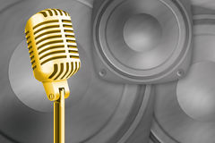 Gold microphone. On the musical background of sound Stock Photo