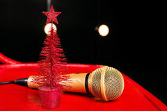 Gold microphone on red wooden backgrounds. Gold microphone on red wooden and dark backgrounds with many lights Stock Photos