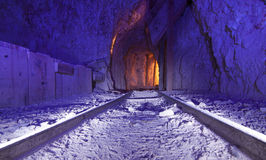 Gold Mine Tracks. Inside an Abandoned Gold Mine with tracks for ore cart and colorful lighting stock images