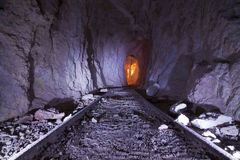 Gold Mine Tracks. Inside an Abandoned Gold Mine with tracks for oar cart and colorful lighting. Golden Pen Mine located in Northern Nevada stock photo