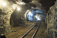 Gold mine tunnels. Perspective shot of gold mine tunnel with rail track for chart stock photos