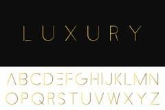 Gold minimalistic font. Luxury english alphabet. Royalty Free Stock Photo