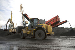 Gold Mining. Front End Loader delivering Gold Ore into truck royalty free stock images