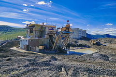 Gold mining by a drag. The thrown settlement. Susuman. The Magadan area. Kolyma Royalty Free Stock Images