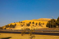 Gold Mining Dumps of Waste material next to the motorway stock photo