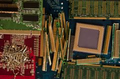 Electronic waste recycling from old computer parts. Gold mining from old computer parts and processors. Gold recovery from computer parts stock image