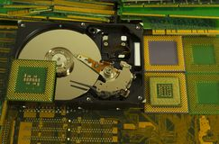 Electronic waste recycling from old computer parts. Gold mining from old computer parts and processors. Gold recovery from computer parts royalty free stock photo