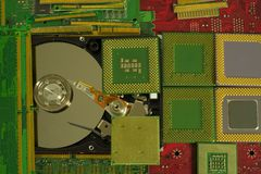 Electronic waste recycling from old computer parts. Gold mining from old computer parts and processors. Gold recovery from computer parts stock photo
