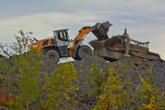 Gold mining in Susuman. An auto-loader and de-rocker. The Magadan area. Kolyma Stock Image