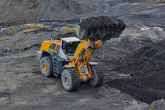 Gold mining in Susuman. An auto-loader with a full ladle stock photo