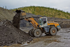 Gold mining in Susuman. The auto-loader works. The Magadan area. Kolyma IMG_1460 Stock Photography